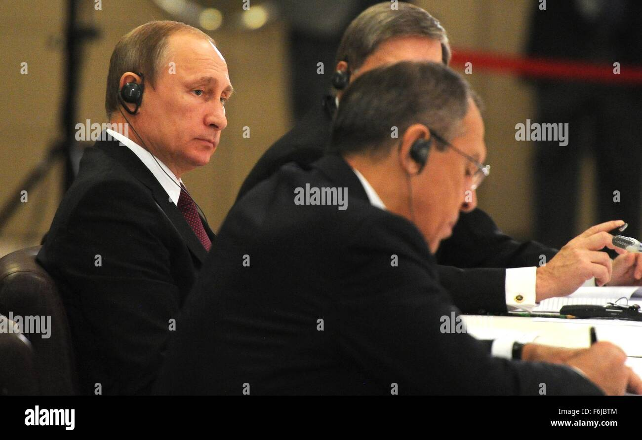 Russian President Vladimir Putin looks toward Russian Foreign Minister Sergei Lavrov during an informal BRICS summit - Stock Image