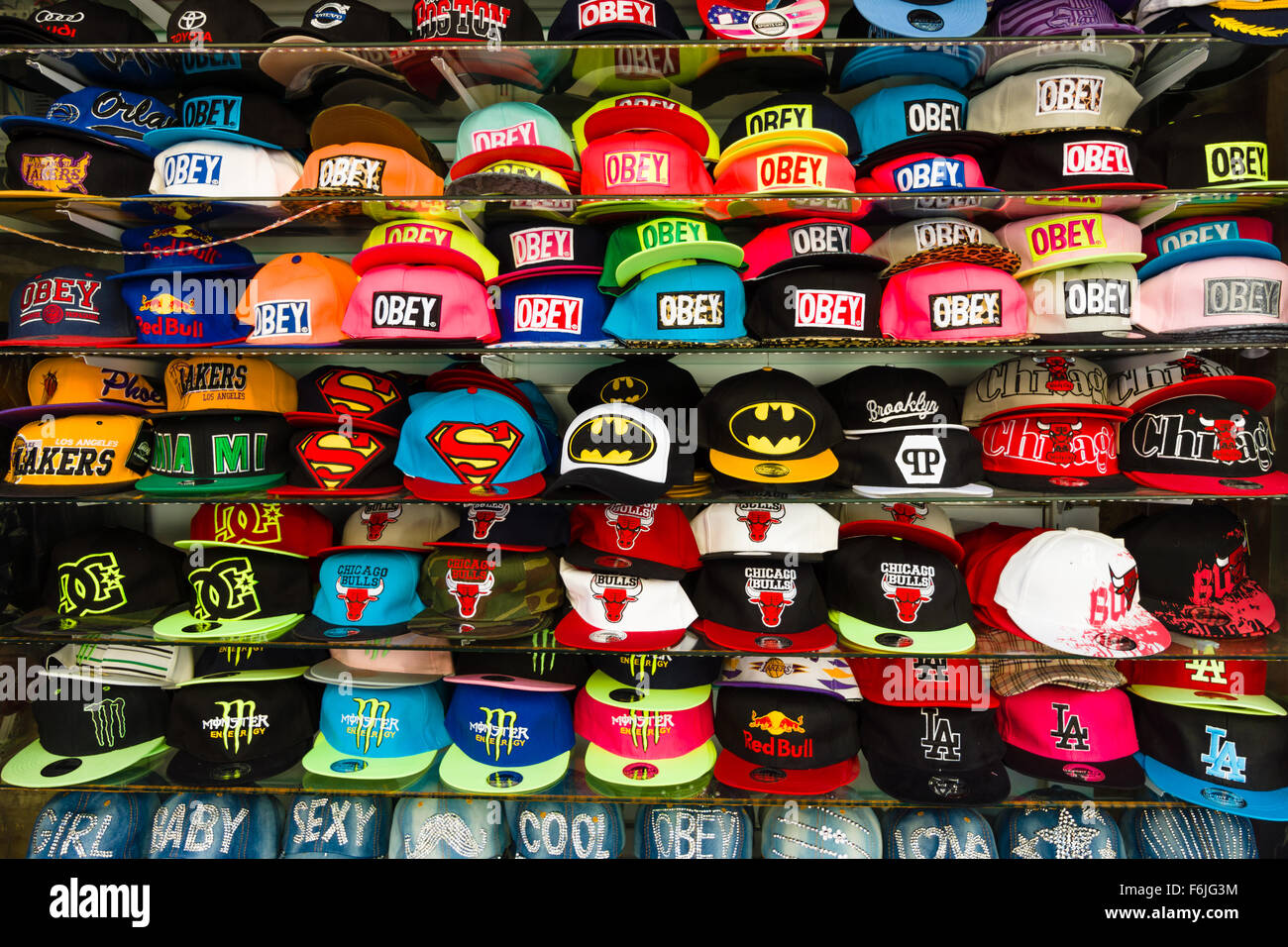 802087866 Baseball caps with different brand names. Shop on the waterfront ...