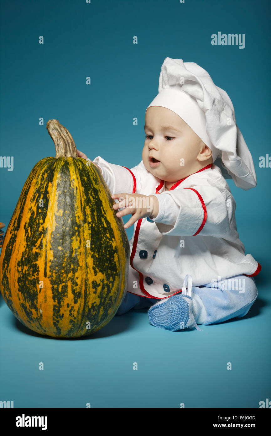 65e4cdb2439b funny baby with cook costume holds pumpkin Stock Photo  90147917 - Alamy
