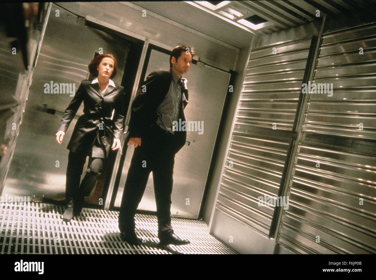 RELEASE DATE: June 19, 1998. MOVIE TITLE: The X-Files: Fight the Future. STUDIO: 20th Century Fox. PLOT: With problems - Stock Image