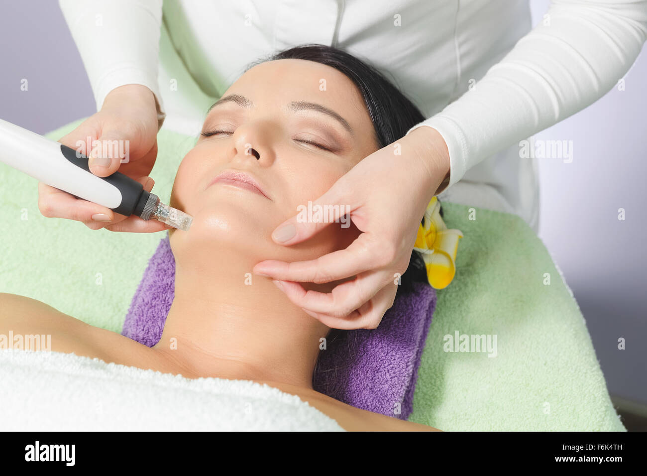 Mesotherapy, anti ageing treatment. Woman having mesotherapy facial treatment at beauty salon - Stock Image