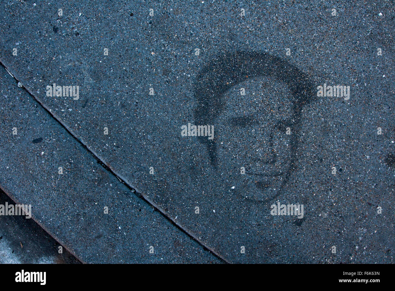 Stencil graffiti on the sidewalk in The Mission in San Francisco, California. - Stock Image