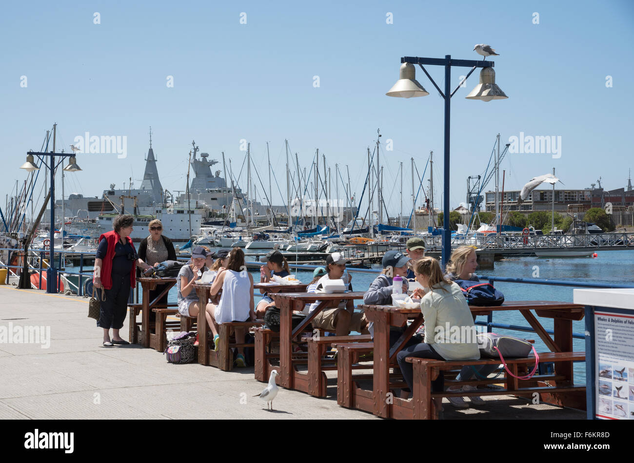 Schoolchildren enjoy a fish and chip lunch during an educational visit to Simon's Town home of the South African Stock Photo