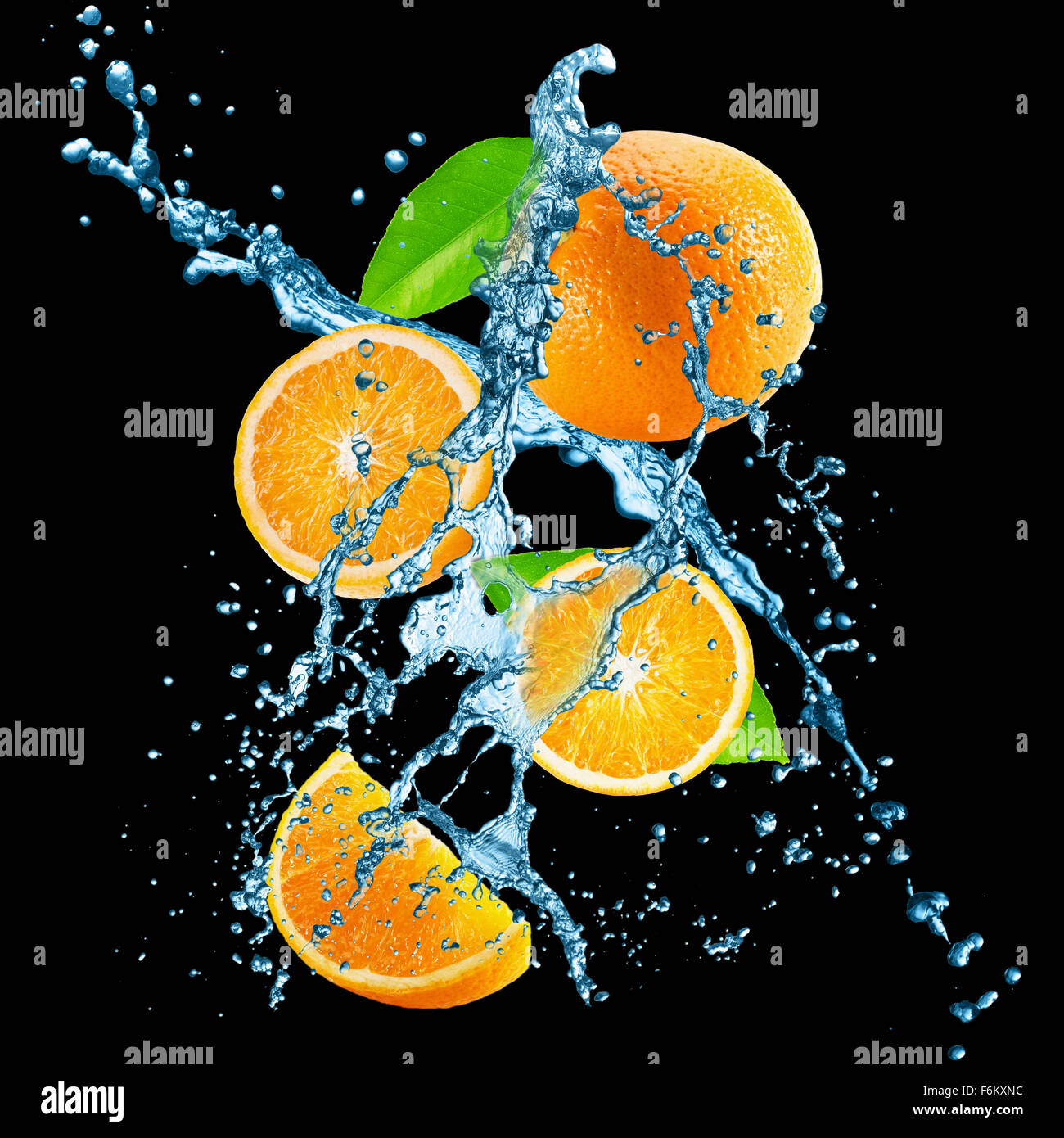 oranges with water splash on the black background. - Stock Image
