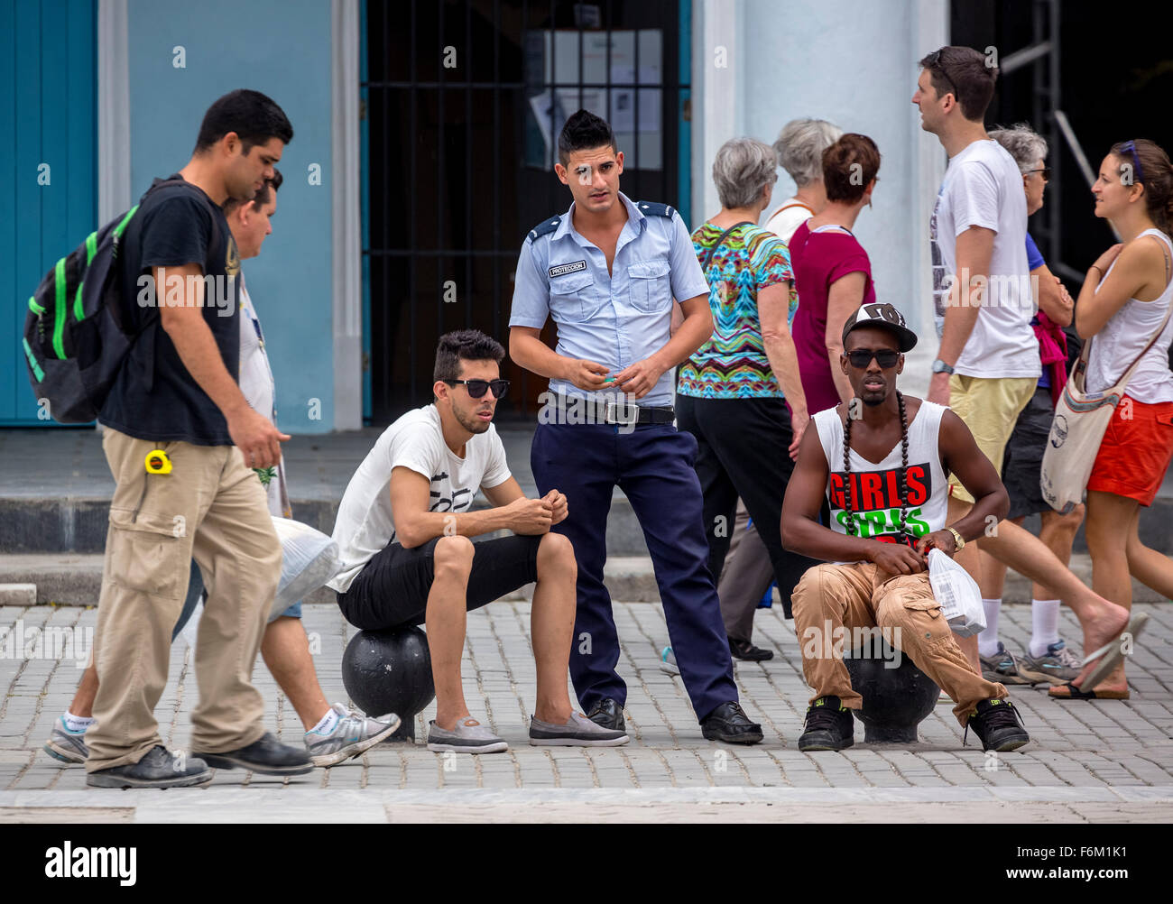 young Canadian policeman with adolescents, young Cubans in a marketplace, Street Scene, La Habana, Cuba, Caribbean, - Stock Image