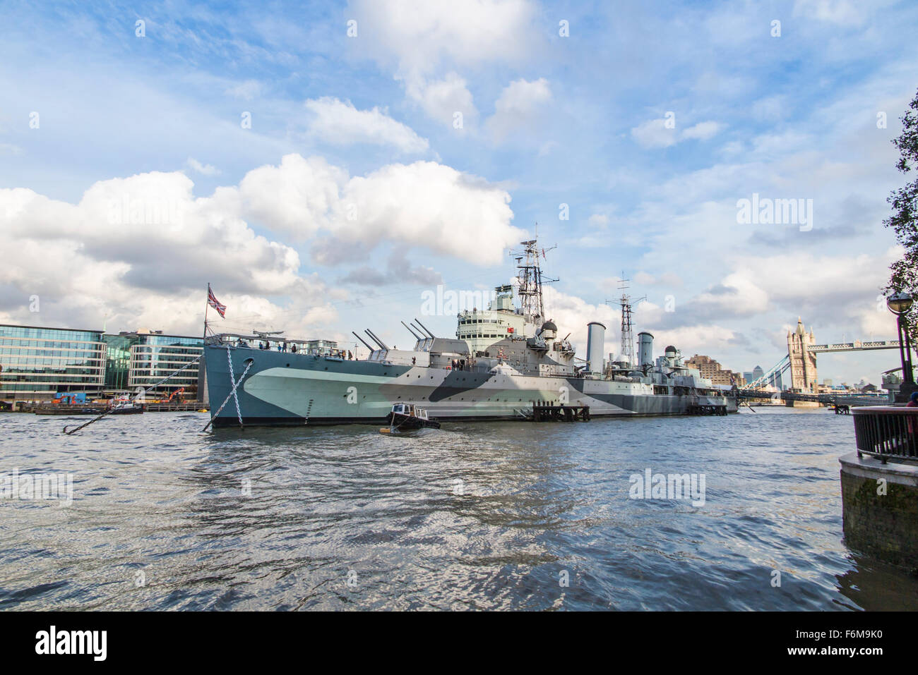 The iconic HMS Belfast light cruiser, a popular museum and tourist attraction, moored on the River Thames in the - Stock Image