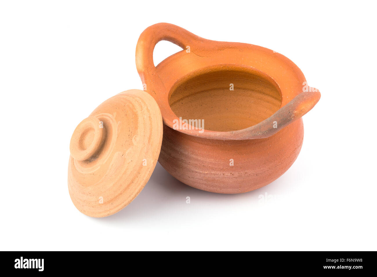 Clay pots are open on white background - Stock Image