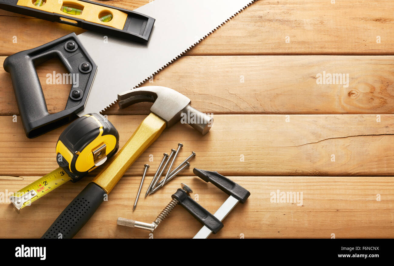 variety of carpentry tools on wood planks with copy space - Stock Image