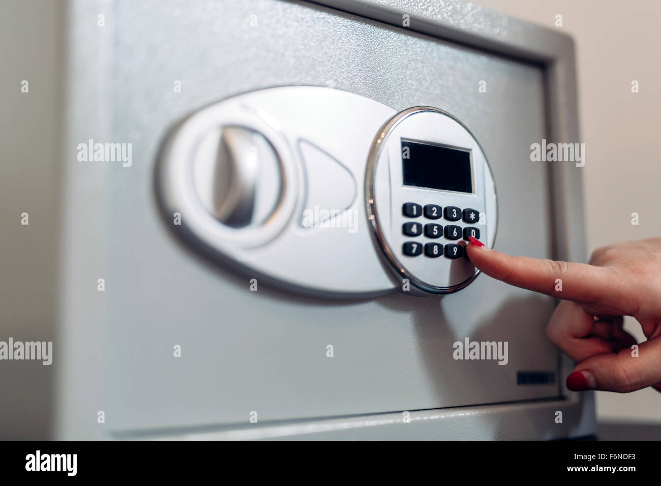 Opening of a safe by typing in security code - Stock Image