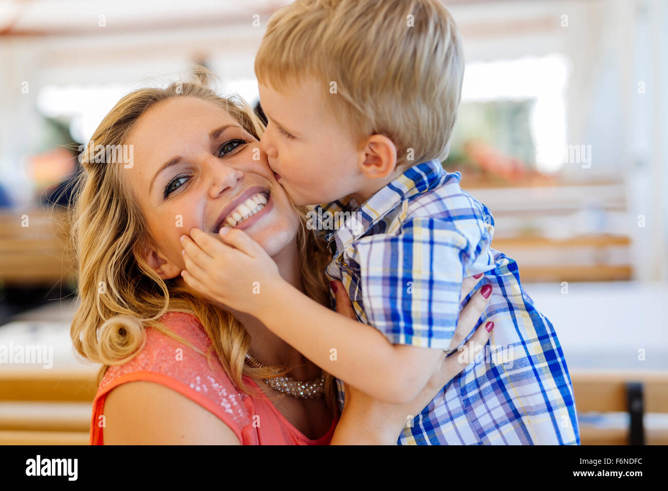 Beautiful mother and child being close to each other and being happy together - Stock Image