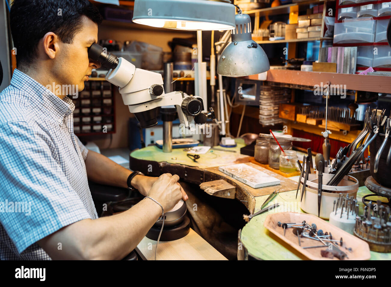 Precision work carried out by jeweler in workshop - Stock Image