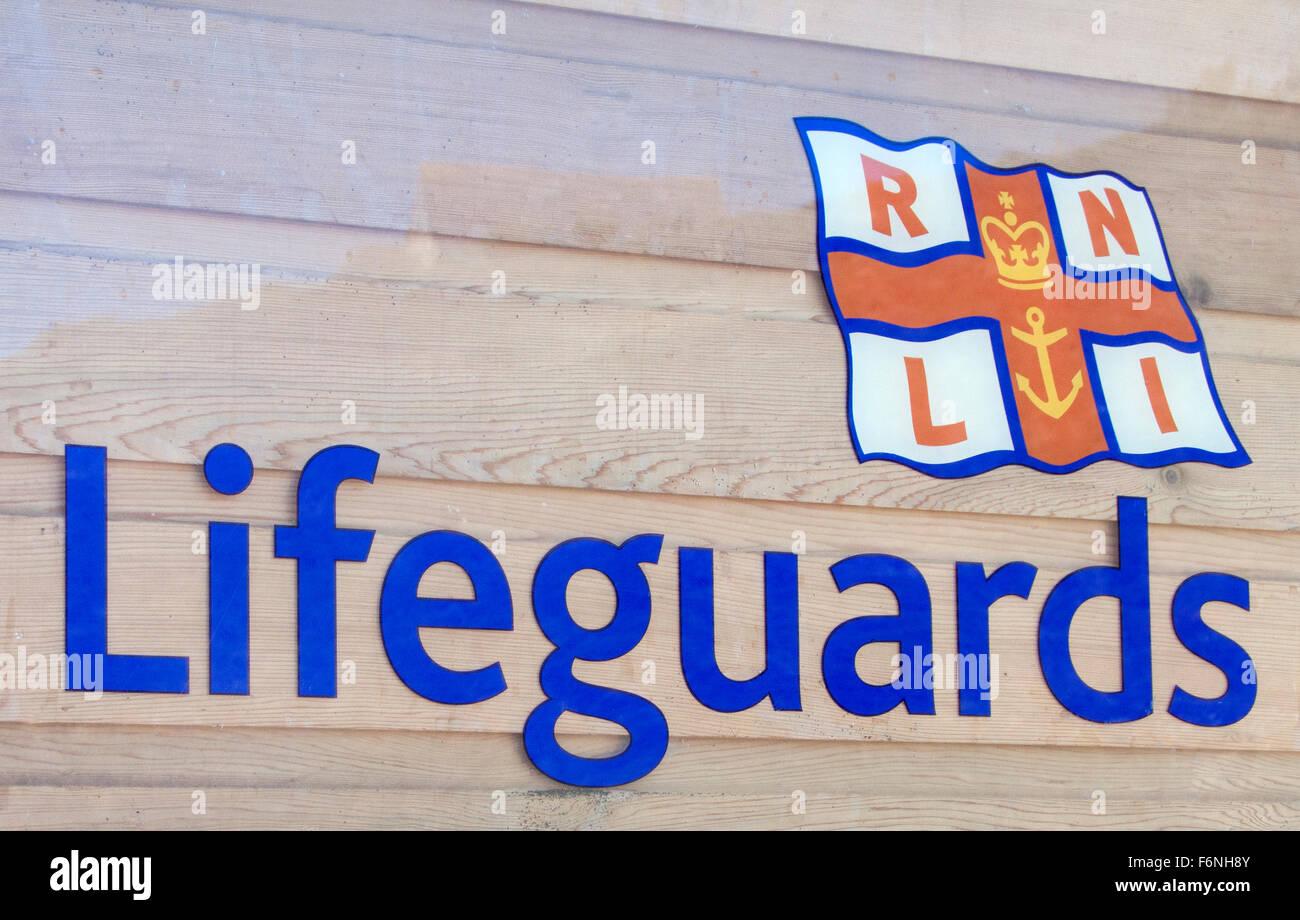 Royal National Lifeboat Institute Lifeguards Sign, UK Stock Photo