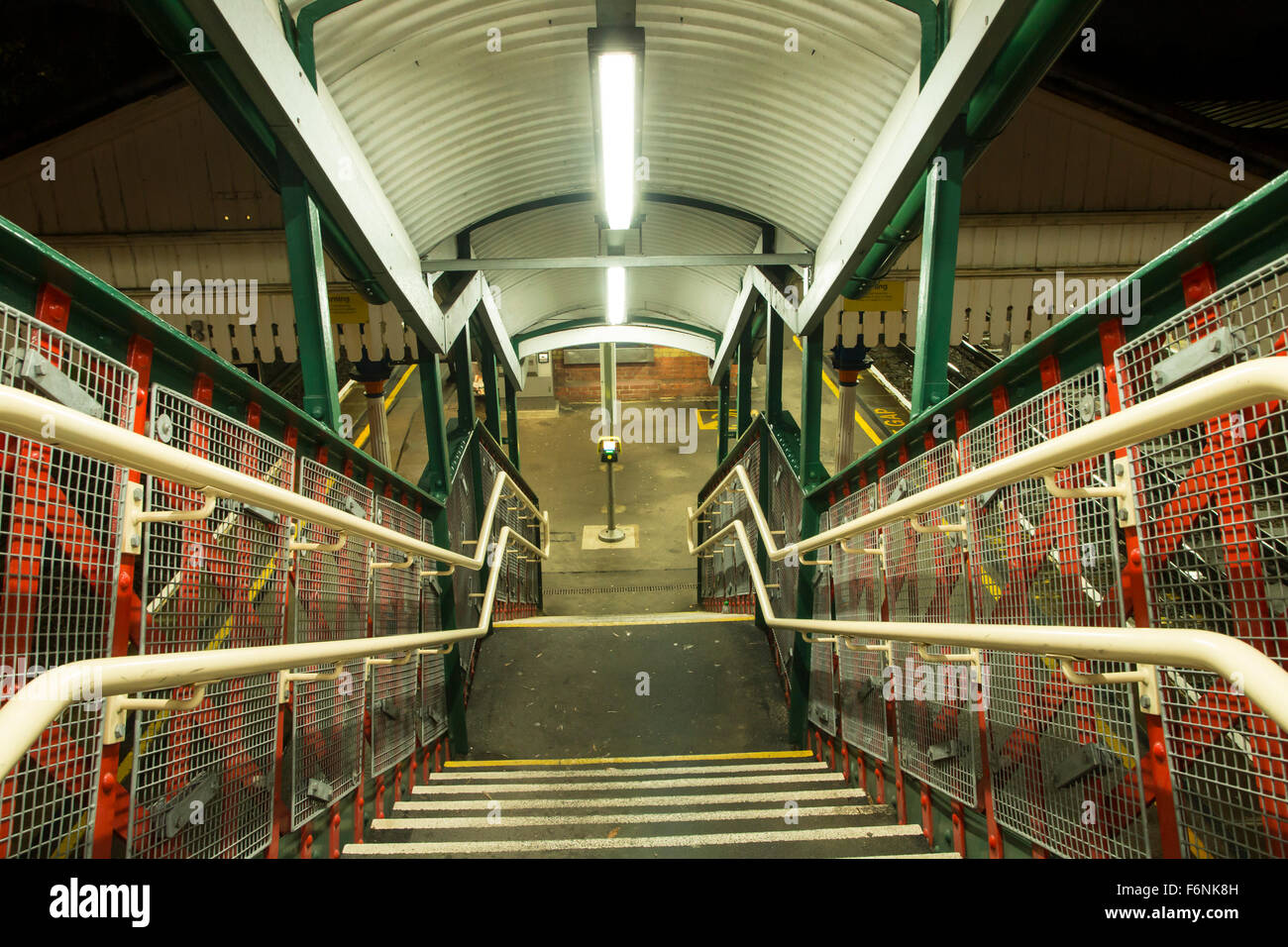 Stairs leading down to the platforms at St Denys railway station, Southampton, Hampshire, UK Stock Photo