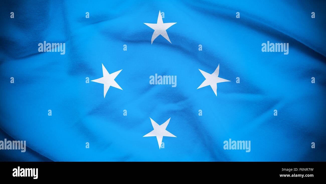 Wavy and rippled national flag of Micronesia background. - Stock Image