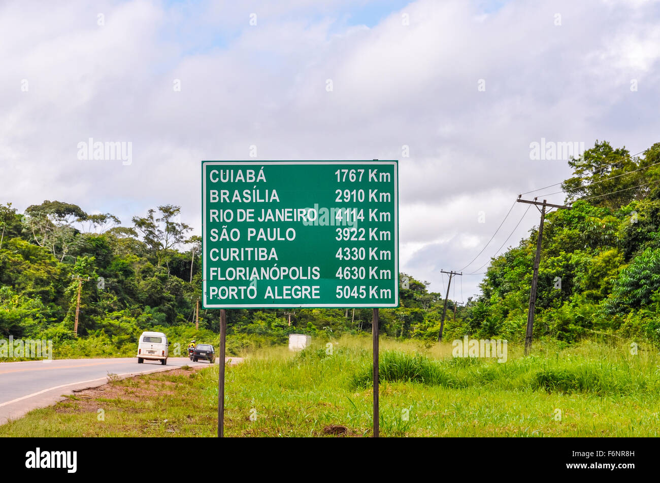 Road sign in the Amazon Rainforest close to Santarem showing everything is far in Brazil - Stock Image