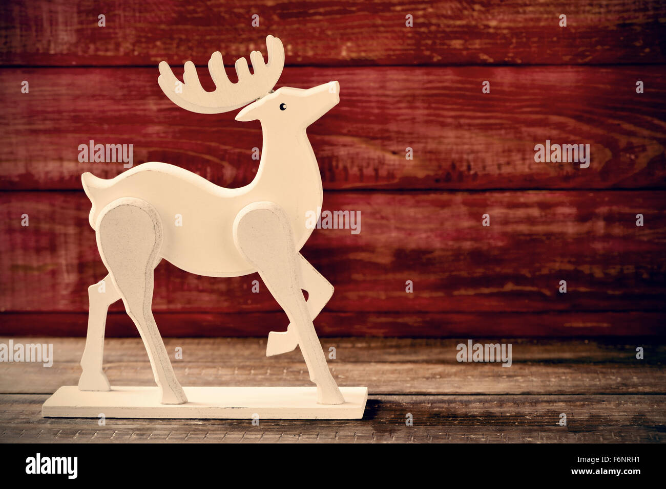 A Wooden Reindeer Shaped Ornament On A Rustic Wooden Surface Stock Photo Alamy