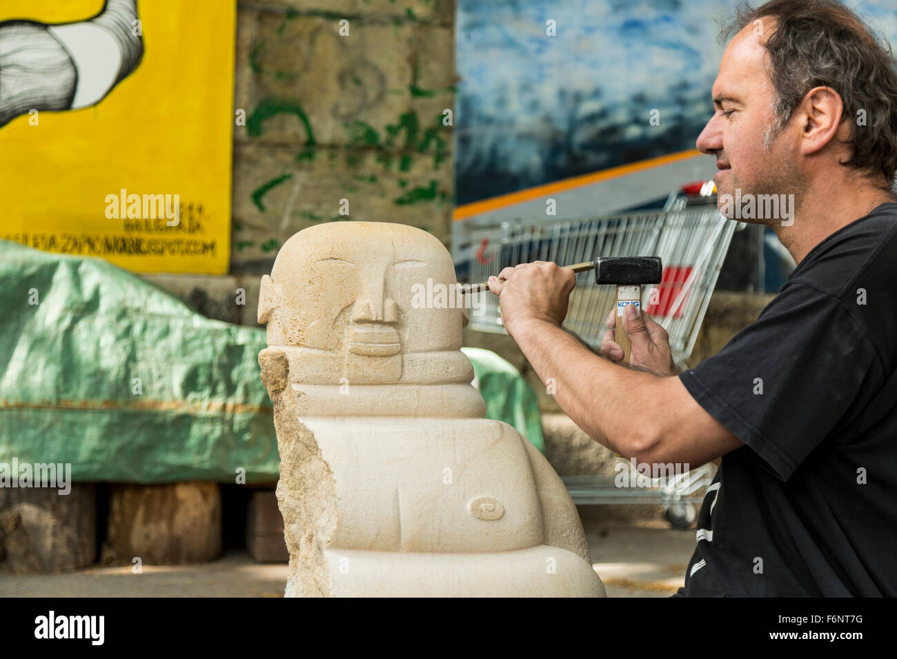 Sculptor Working on a Piece at Danube Canal Vienna - Stock Image