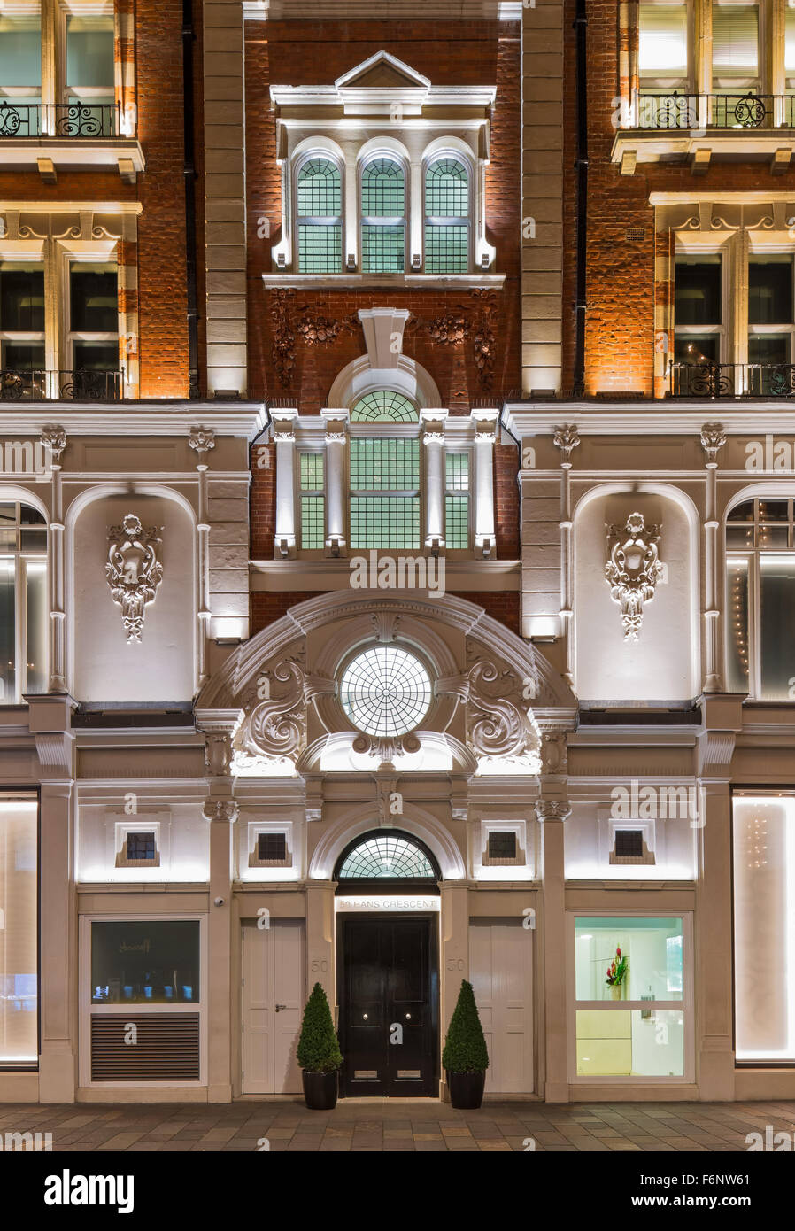 Floodlit retained facade at 50 Hans Crescent, Knightsbridge London. - Stock Image