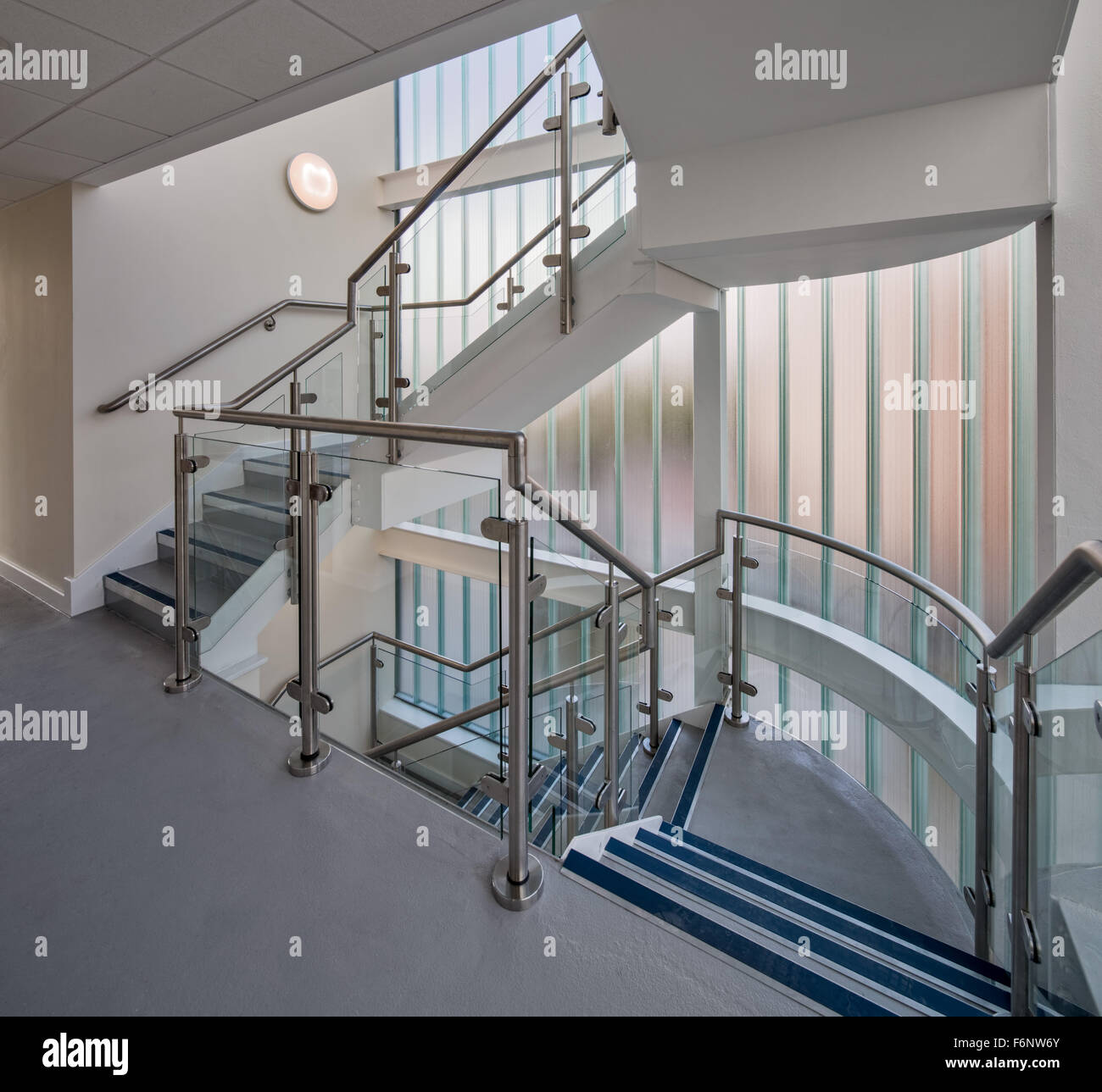 Modern staircase with glass walls - Stock Image