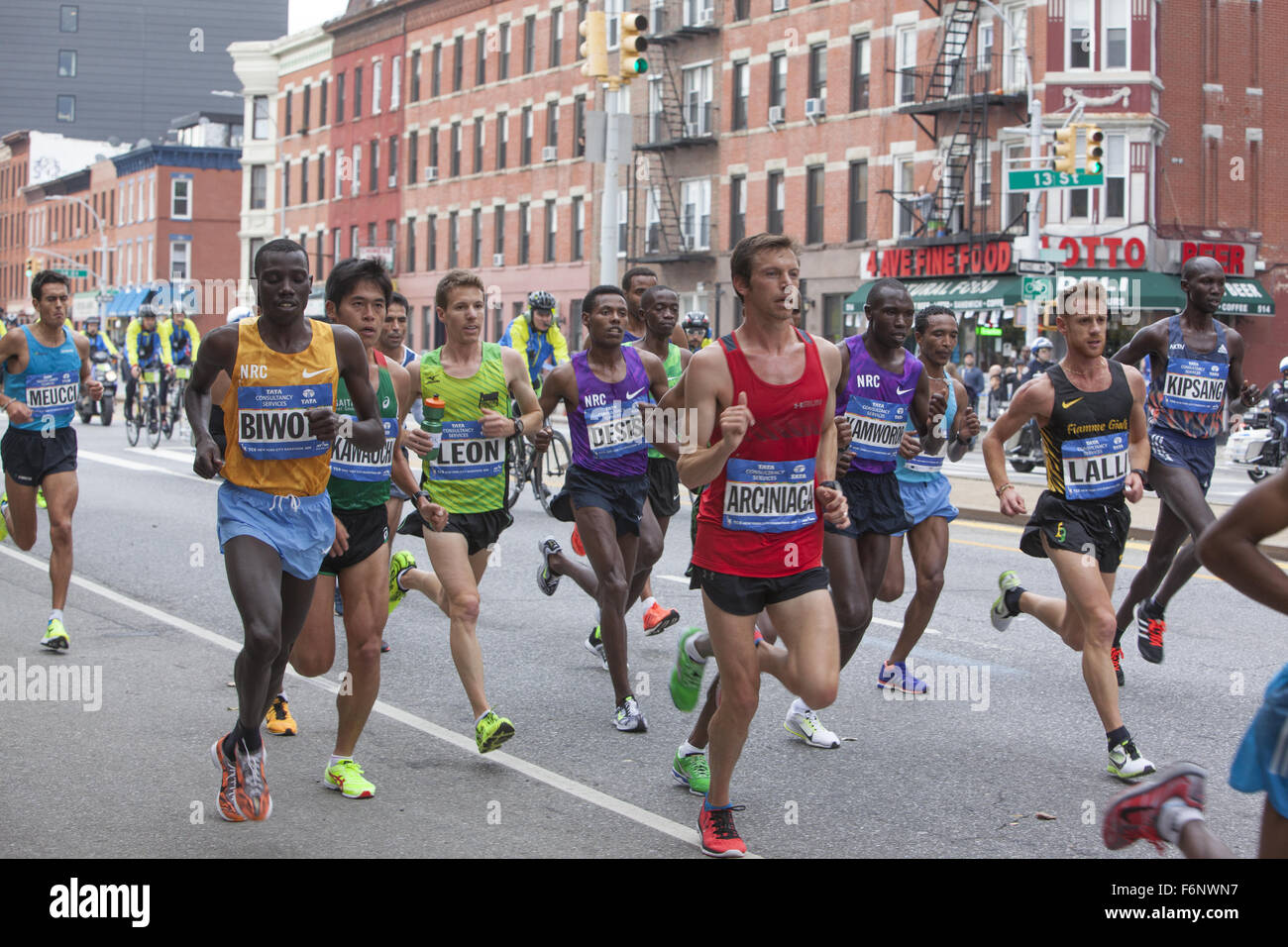 Front runners in the NYC Marathon 2015 along 4th Ave. in Brooklyn with Stanley Biwott (left) of Kenya the eventual - Stock Image