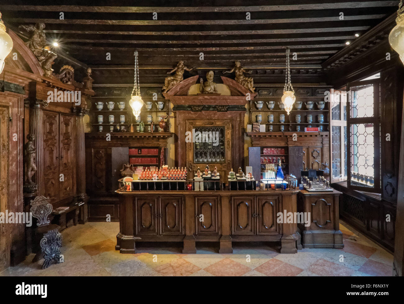 Oldest pharmacy in Venice on the Strada Nuova. The apothecary room is decorated with majolica vases and carved walnut Stock Photo