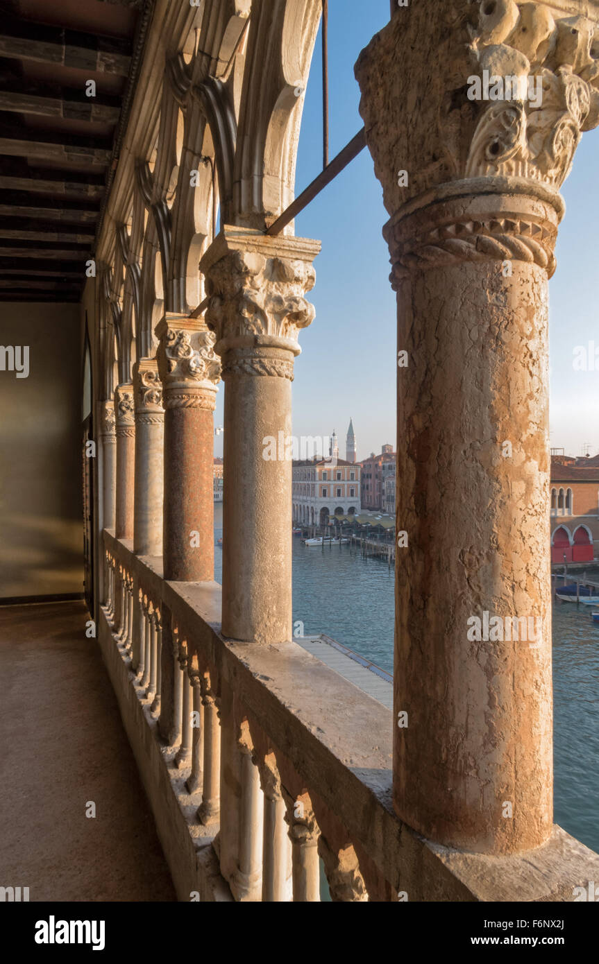 Columns at the Ca D'Oro gothic Palace in Venice Italy. View of the campanile at San Marco - Stock Image