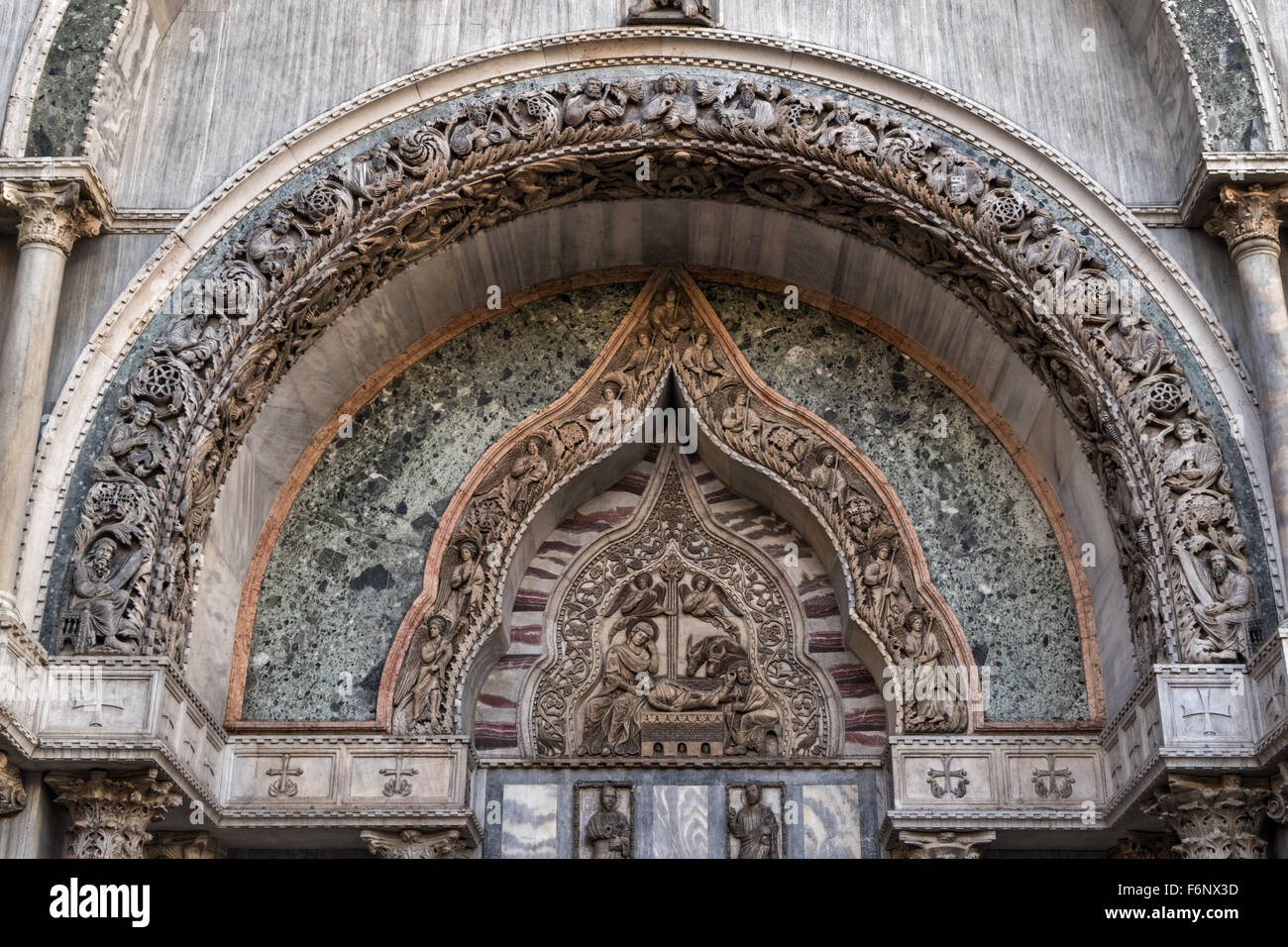 Ornate arch above the entrance to the Doge's Palace, Venice - Stock Image