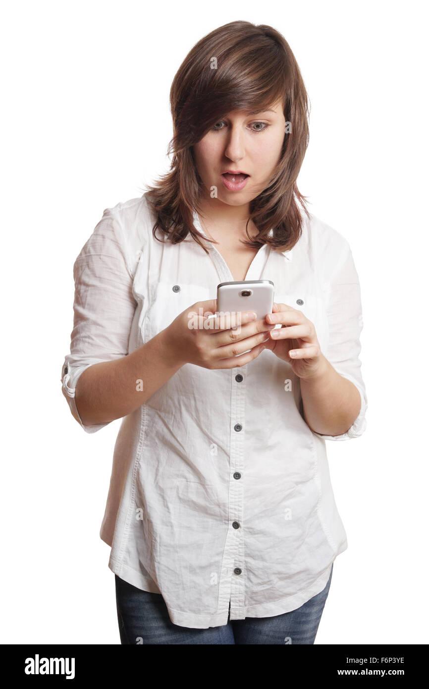 shocked girl staring at smartphone - Stock Image