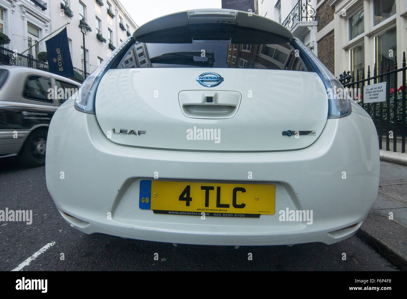 Nissan Leaf electric car.  Eco friendly car.   Ecological driver.   Saving the planet,  customised number plate - Stock Image