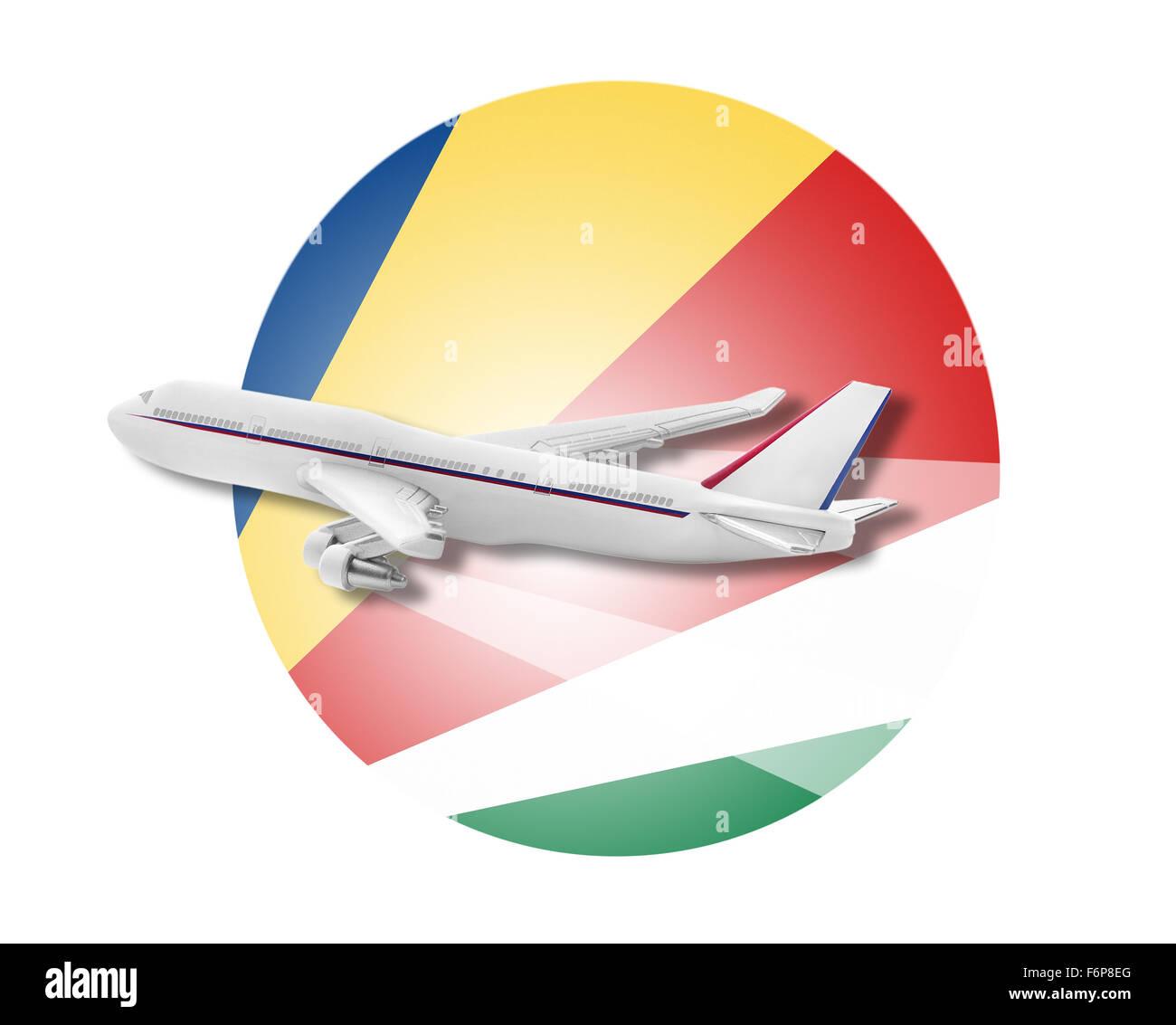 Plane and Seychelles flag. - Stock Image