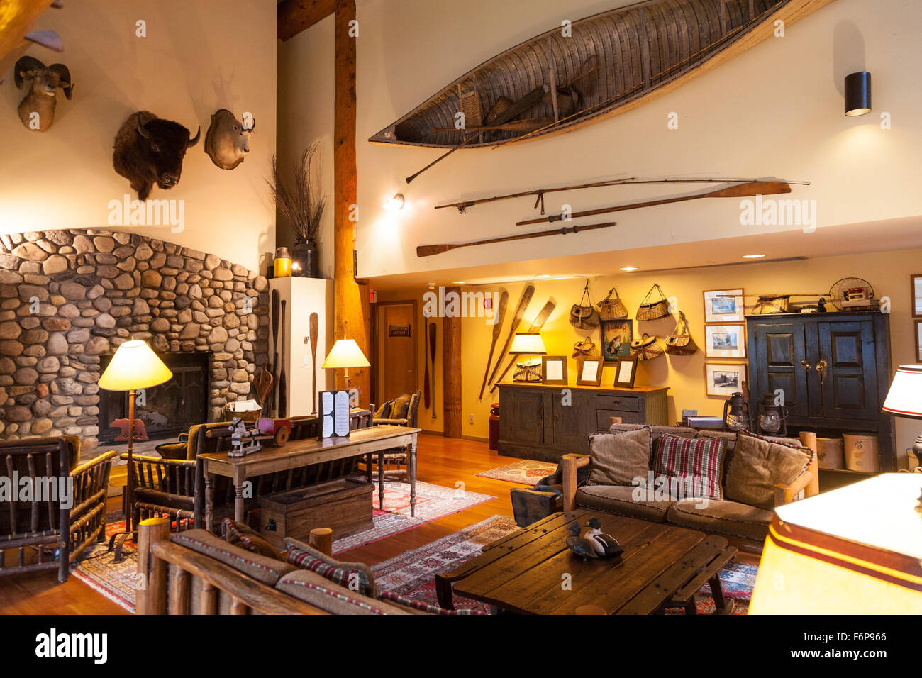 The lounge or sitting room with mementos and memorabilia at Moraine Lake Lodge Banff National Park Alberta Canada - Stock Image