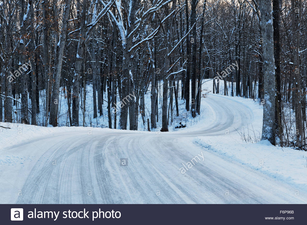 Curvey country road in winter, after a fresh snow. Sounthern Indiana - Stock Image