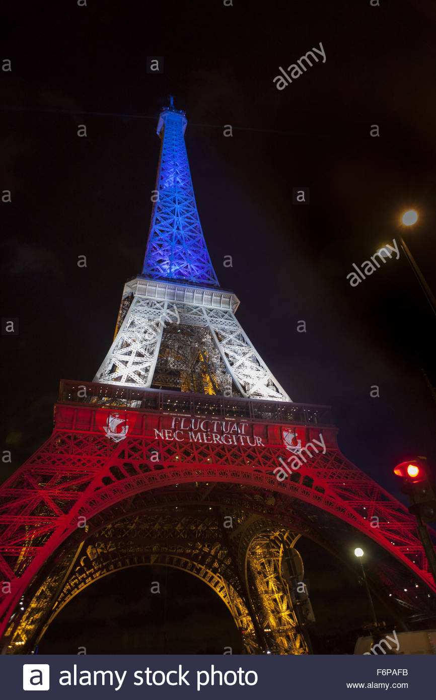 Paris, France. November 18th, 2015. FRANCE, Paris: Eiffel Tower is seen illuminated with the colors of French flag - Stock Image