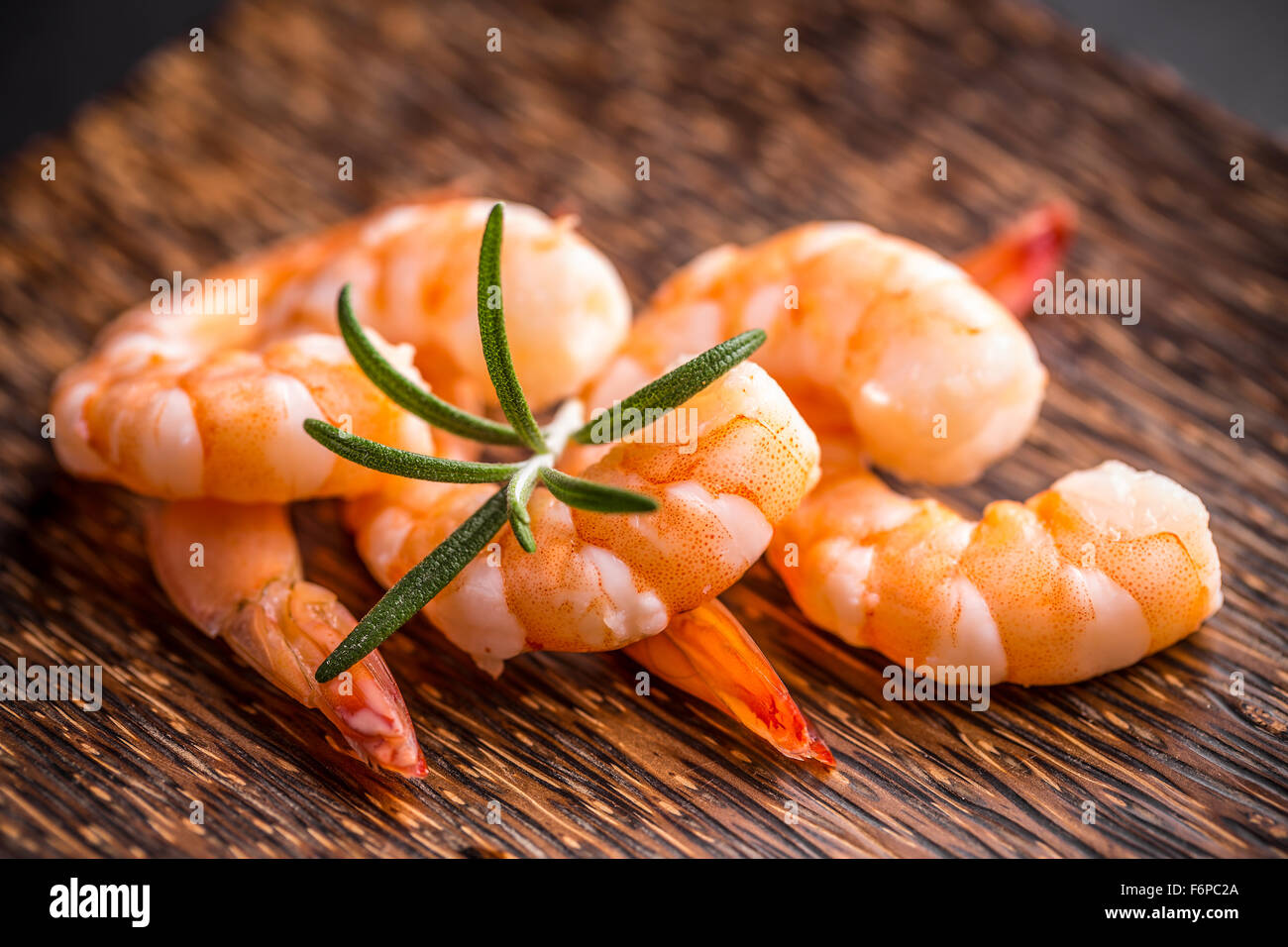 Close up of prawns with rosemary - Stock Image