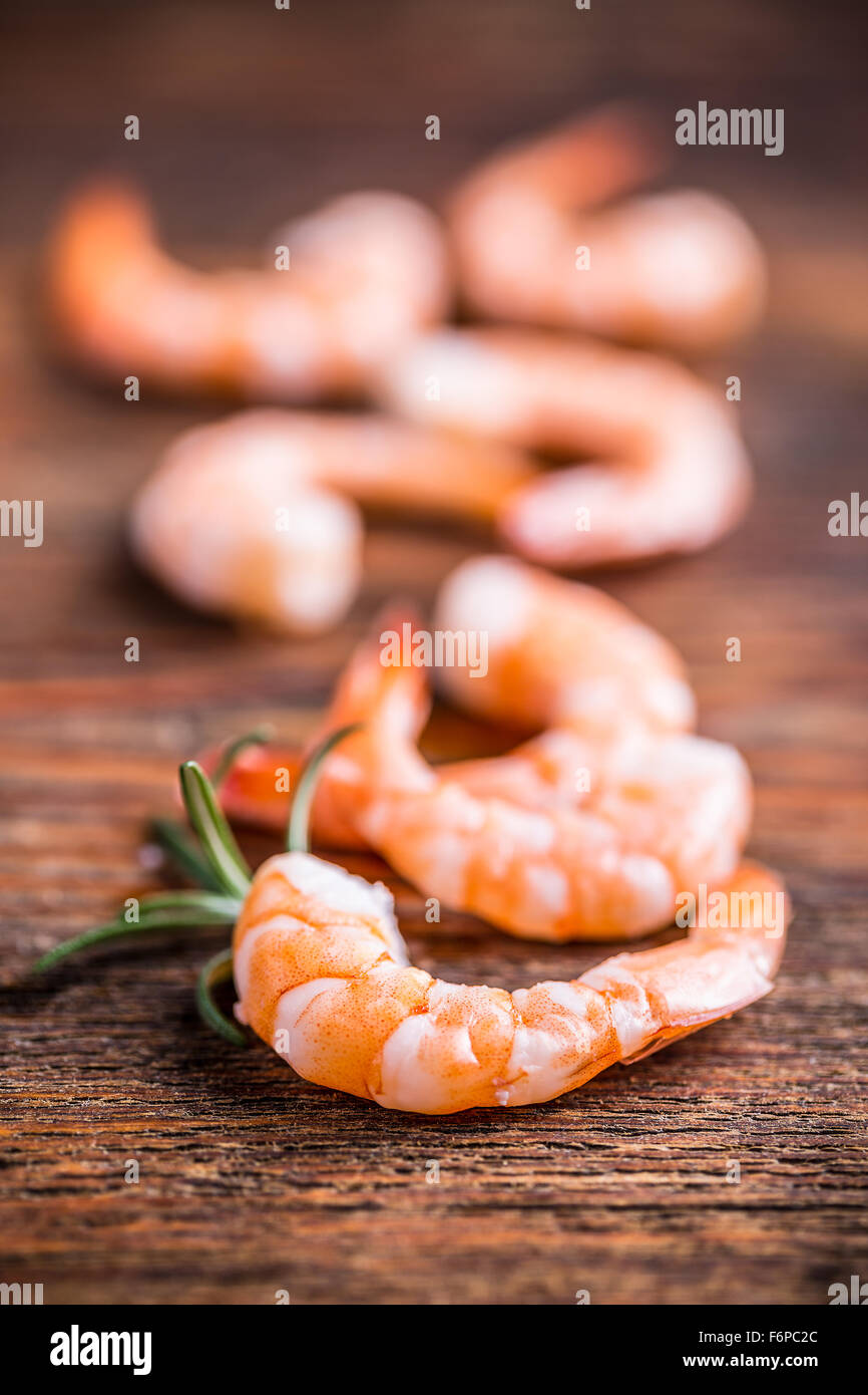 Raw prawns on wooden background - Stock Image