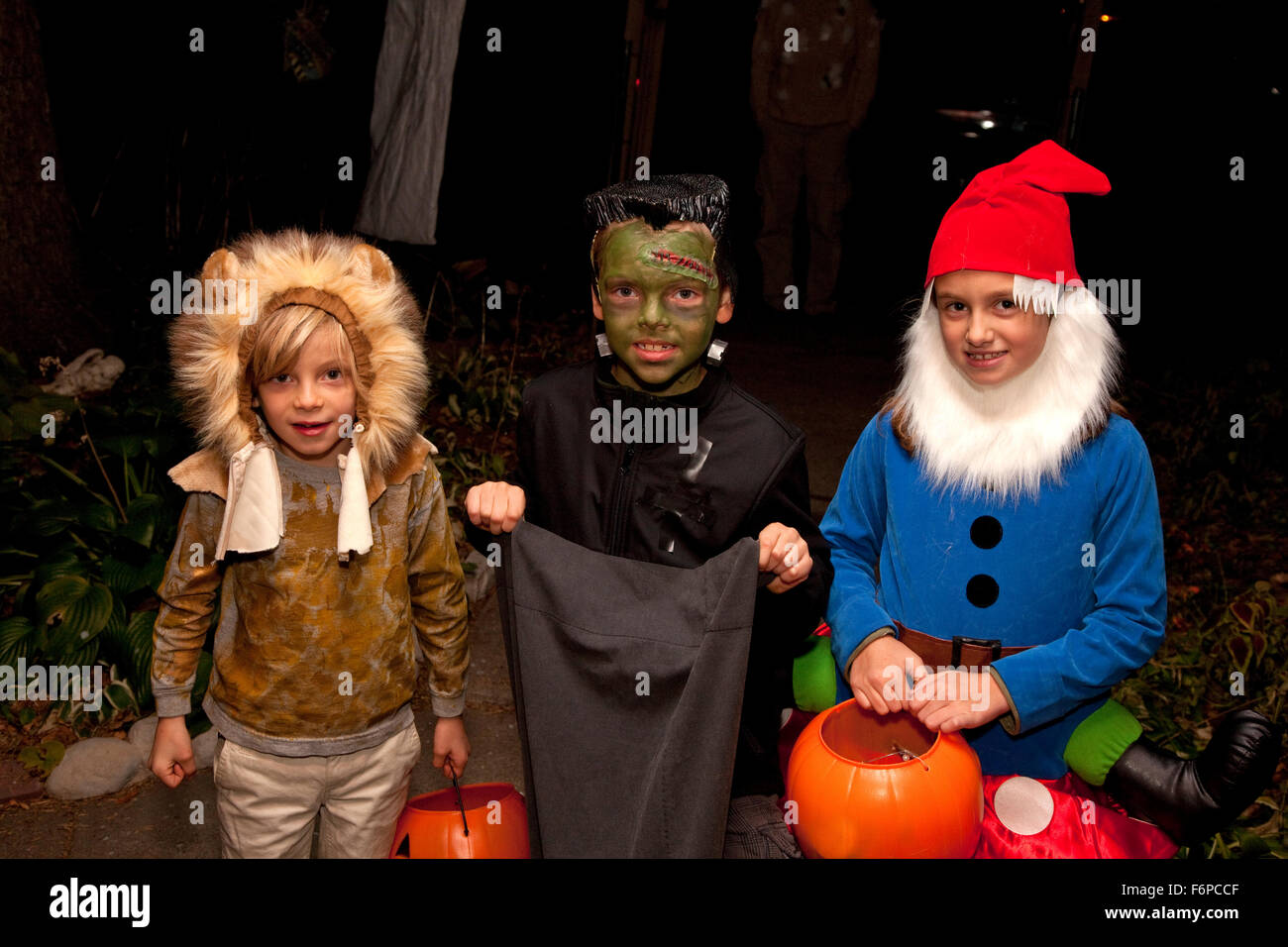 Halloween Costumes For 3 Kids.Three Kids Dressed In Their Halloween Costumes Trick Or