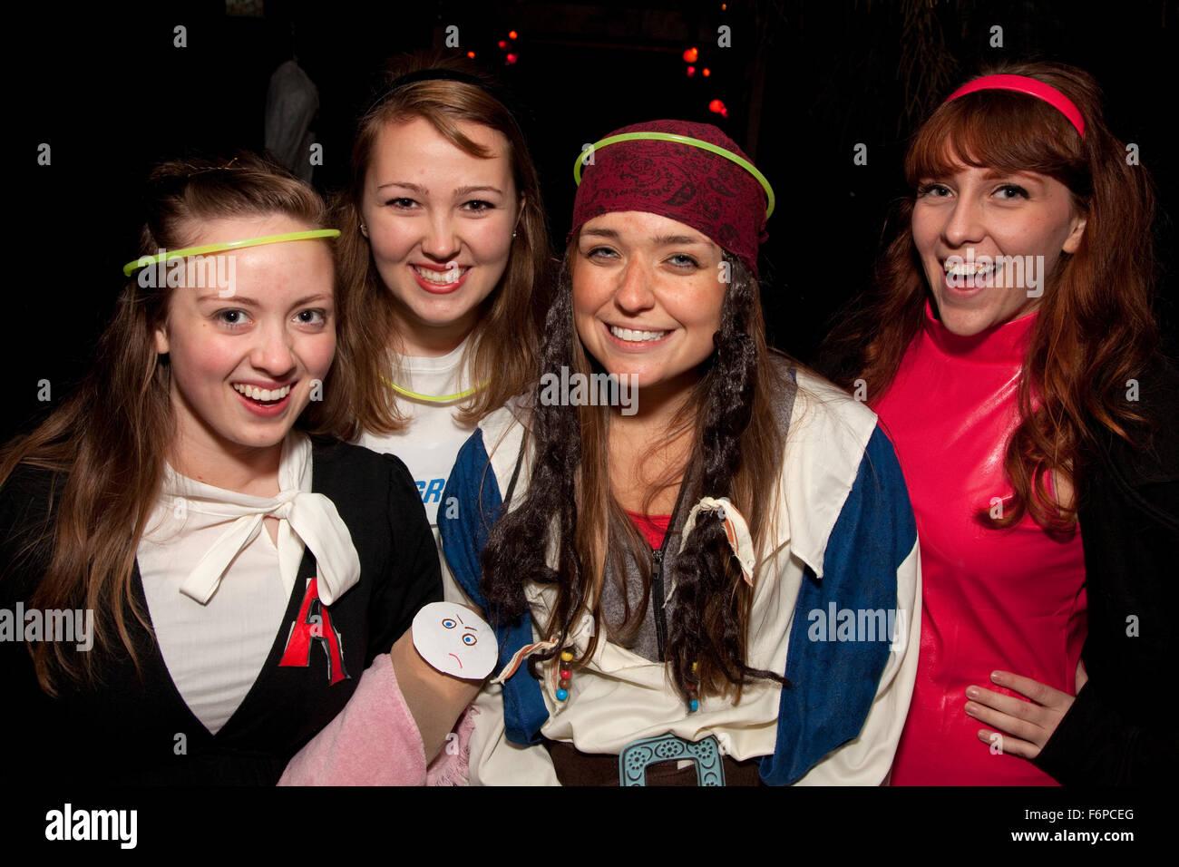 Costumed Halloween trick or treating teen girls. St Paul Minnesota MN USA - Stock Image