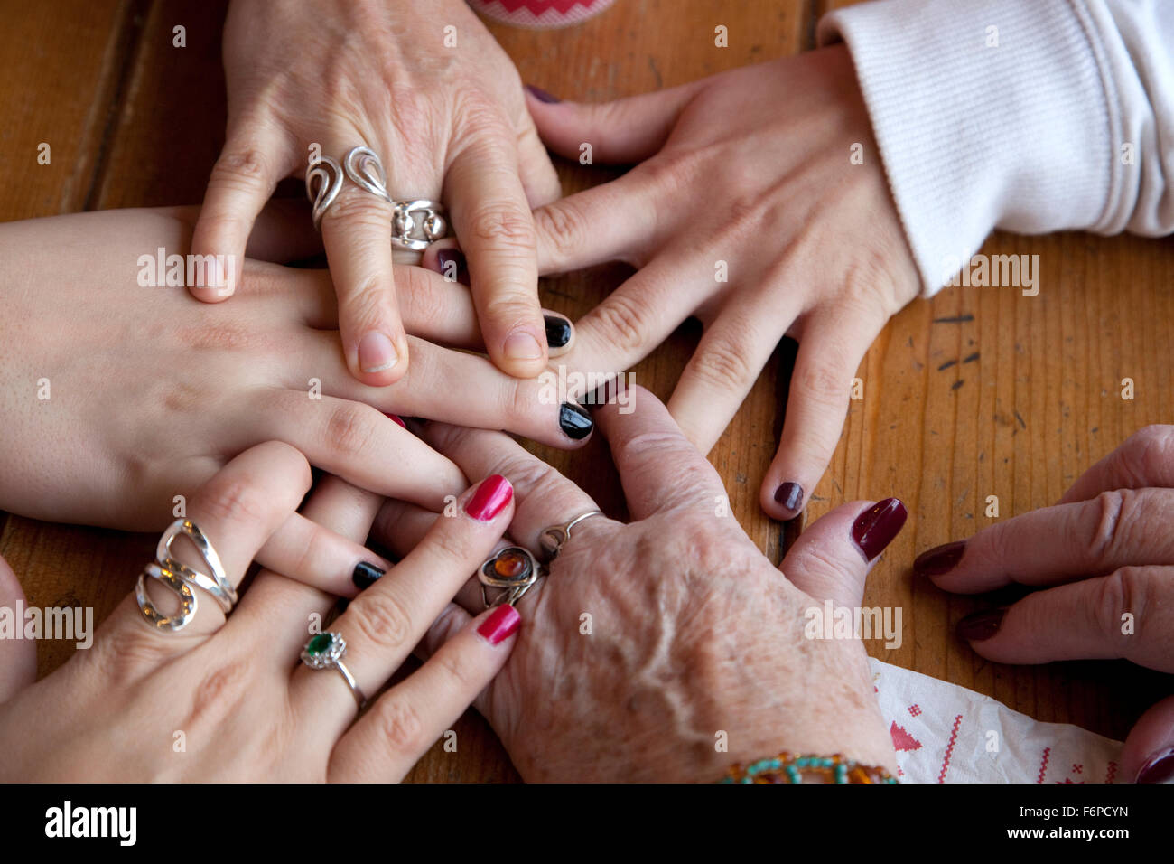 Hands of three generations of nieces. Downers Grove Illinois IL USA - Stock Image