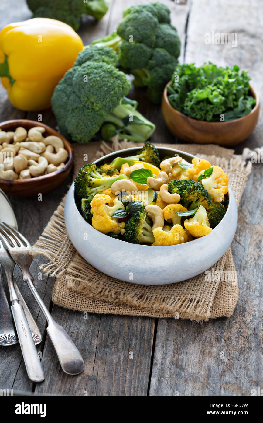 Vegetable curry with broccoli, cauliflower, kale cashew nuts - Stock Image