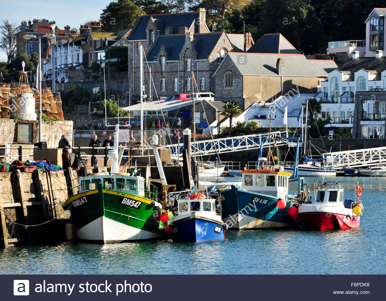 Fishing boats lined up in Brixham Harbour, Torbay, Devon - Stock Image