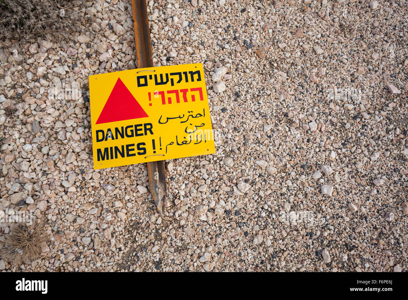 Mine field warning sign in Hebrew, Arabic and English at Mount Hermon. Golan Heights. Israel. - Stock Image