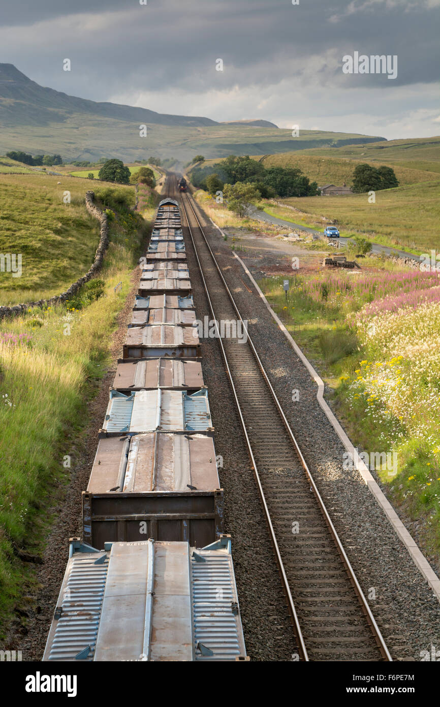 Goods train on the Settle to Carlisle railway line on the Aisgill incline up Mallerstand, Cumbria, UK. - Stock Image