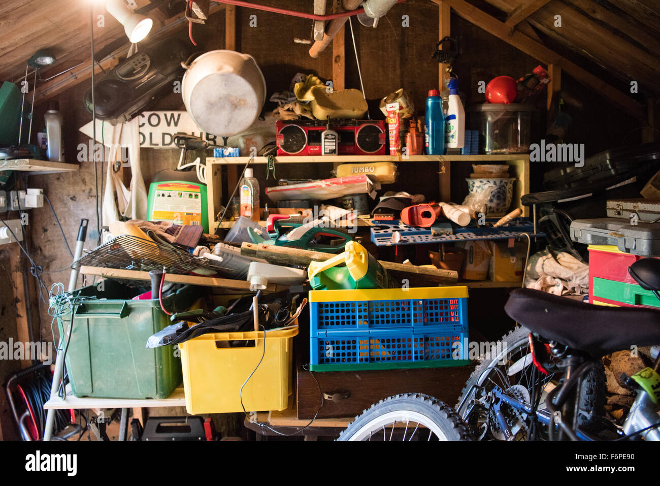 Inside A Messy And Cluttered Wooden Garage Shed With Tools