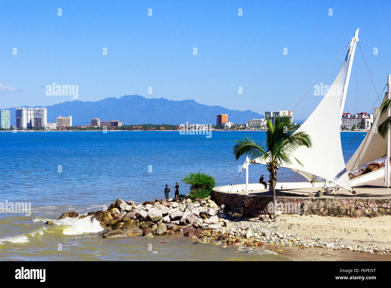 Bay of Banderas from the promenade and boardwalk at El centro district of Puerto Vallarta, Mexico with the Sierra Stock Photo