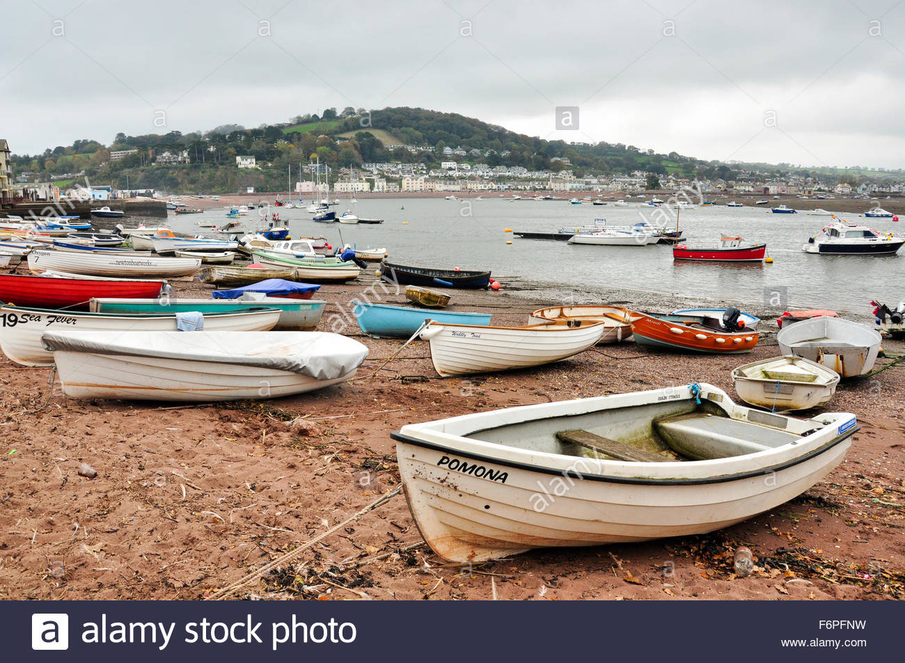 Boats on the beach at Teignmouth in Devon, with Shaldon viewed in the background Stock Photo