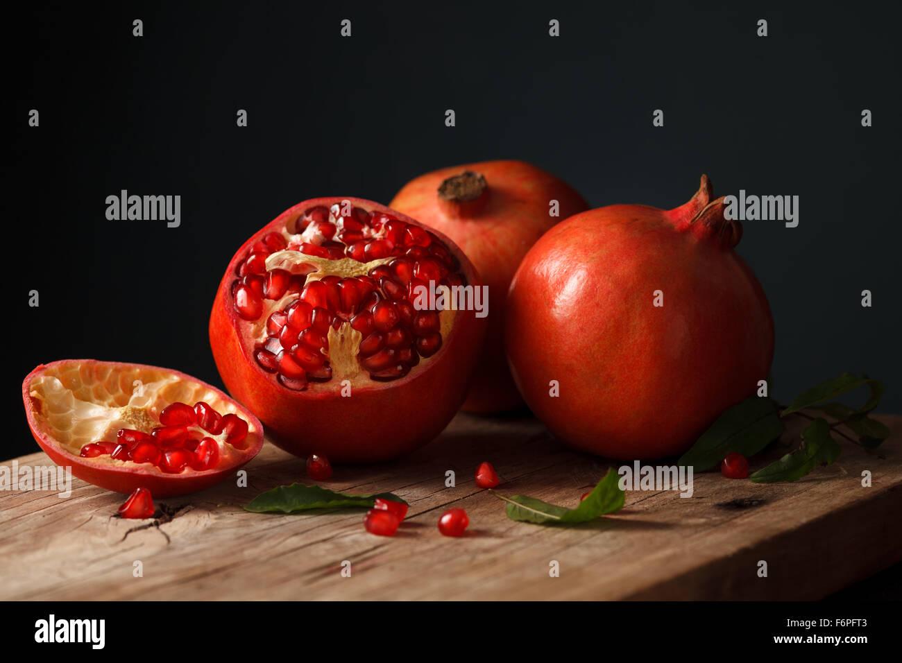 pomegranate fruit healthy food fresh organic still life vegetarian juicy antioxidant - Stock Image