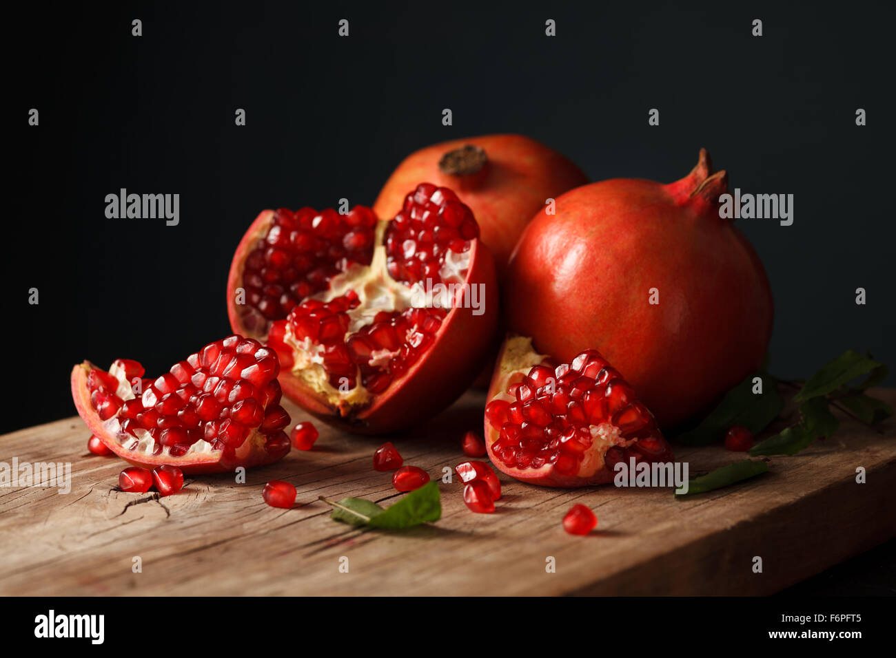 pomegranate fruit healthy food fresh organic still life vegetarian juicy antioxidant - Stock Image