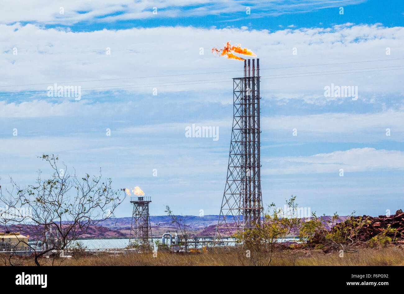 Australia, Western Australia, Pilbara, Karratha, gas flare stacks at Woodside gas processing plant on the Burrup - Stock Image