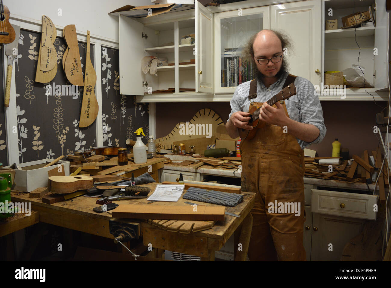 Luthier, Liam Kirby, in his ukulele and guitar workshop ...