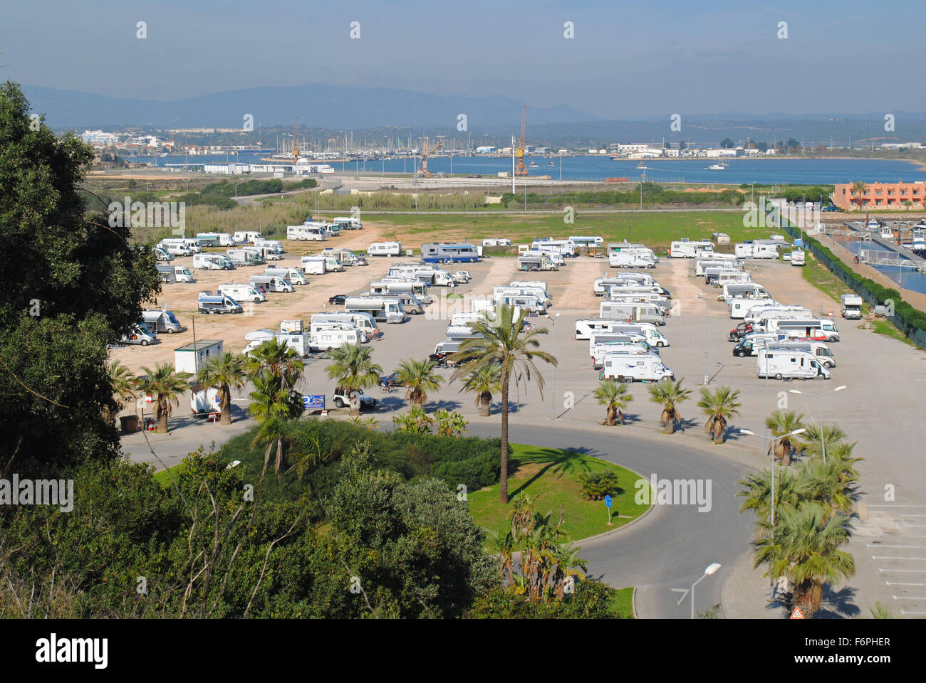 A large motorhome parking area next to the marina in Portimão, Portugal. - Stock Image